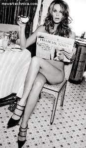 Elle Macpherson reading the Financial Times upside-down, nude