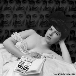 Young woman, wearing negligee, lying in bed, holding book, with OSAMA BIN LADEN!!